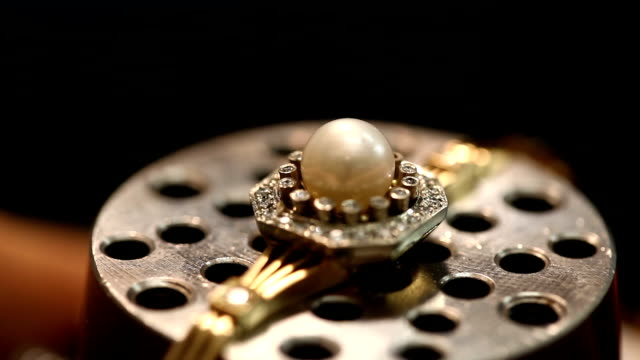 hand made ring with pearl. finishing touches - stone object stock videos and b-roll footage