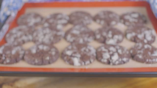 hand make chocolate biscuits with snow icing sugar - tray stock videos and b-roll footage