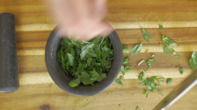 hand making basil paste - mortar and pestle stock videos and b-roll footage