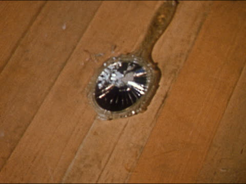 1955 hand mirror falling onto wood floor and breaking