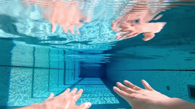 hand movements of woman sculling in swimming pool - sculling video stock e b–roll