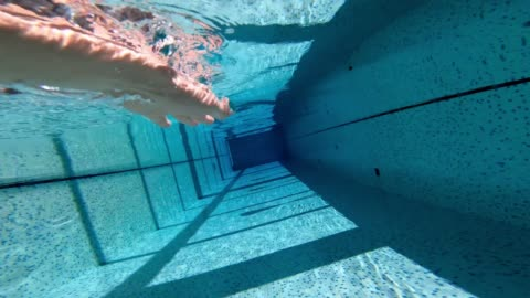 hand movements of woman swimming freestyle in pool - length stock videos & royalty-free footage