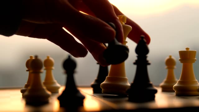 hand moving chess game - chess stock videos & royalty-free footage