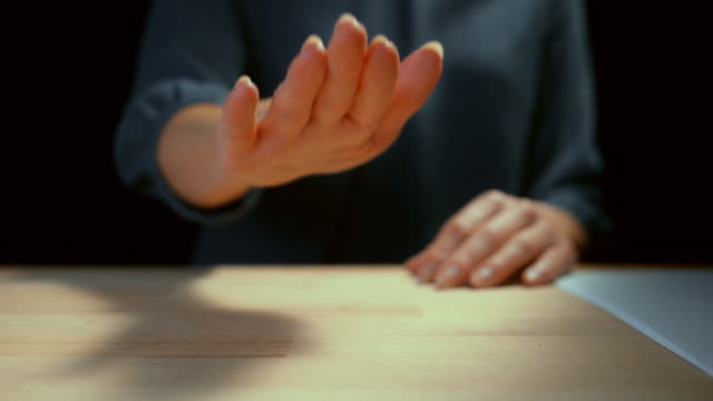 slo mo ld hand of a businesswoman striking the desk - gesturing stock videos & royalty-free footage