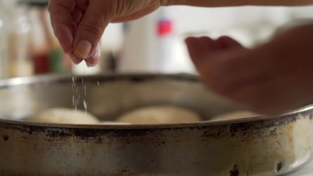 hand of a cook adding ingredient on food - pinching stock videos & royalty-free footage