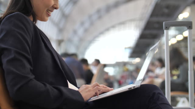 hand of businesswoman using laptop at airport - using laptop stock videos & royalty-free footage