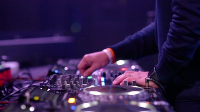 hand of dj decks / turntable at disco party nightclub - deck stock videos & royalty-free footage