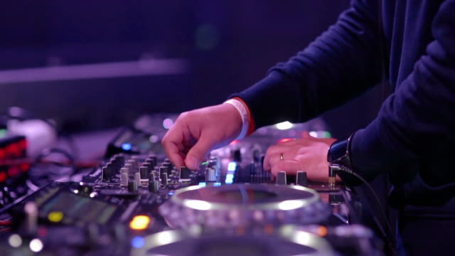 hand of dj decks / turntable at disco party nightclub - stereo stock videos and b-roll footage