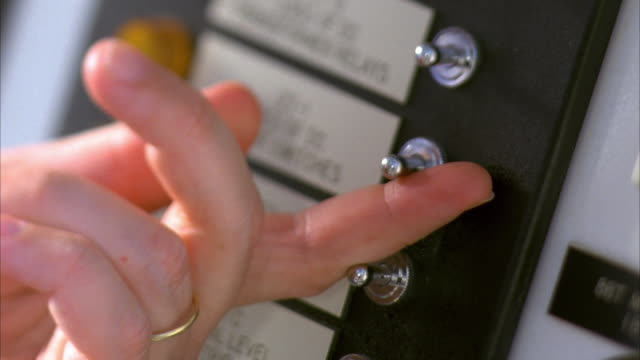 slo mo cu tu hand of lineman flipping switches on control panel / cedar park, texas, usa - cedar park texas stock videos & royalty-free footage