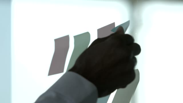 hand of male professional sticking blank notes - adhesive note stock videos & royalty-free footage