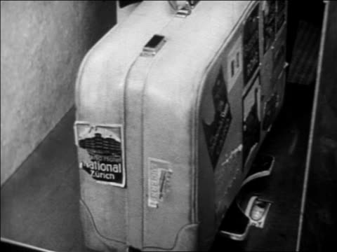b/w 1933 hand of man placing worn luggage on scale at airport check-in counter - 1933 stock videos & royalty-free footage