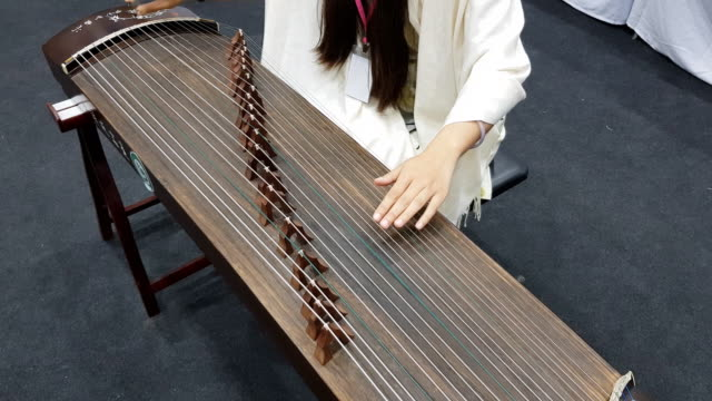 hand of man playing guzheng.the guzheng or gu zheng, also simply called zheng, is a chinese instrument - ancient stock videos & royalty-free footage
