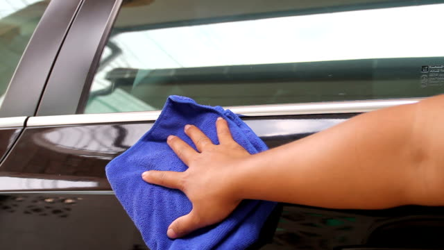 hand of Man washing and cleaning car