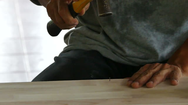 hand of man worker hammering - hammer stock videos and b-roll footage