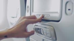 Hand of passenger watching movie