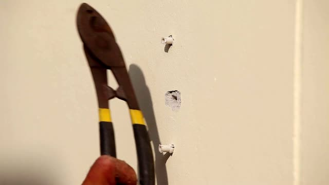 hand of technician worker using an electric hand drill a wall prepare to install plug cable electric wire box, close up shot. - cable box stock videos and b-roll footage