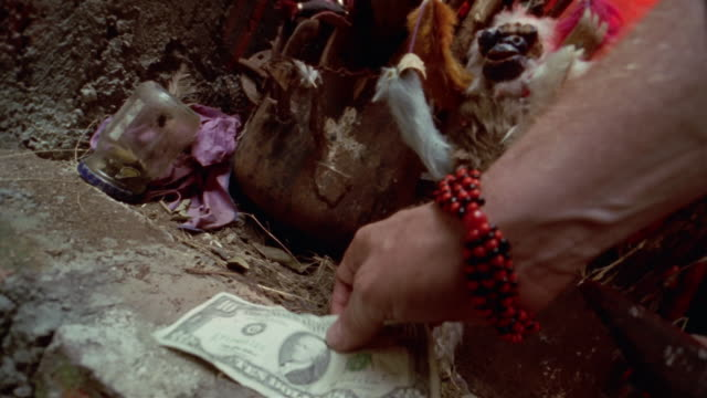 cu, hand of unrecognizable person placing ten dollar banknote on stone, havana, cuba  - only mature men stock videos & royalty-free footage