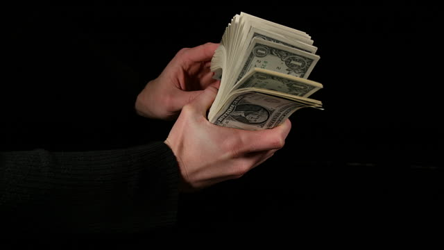 vídeos de stock, filmes e b-roll de hand of woman and dollar bank notes, slow motion 4k - stack