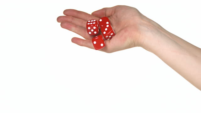 vídeos y material grabado en eventos de stock de hand of woman throwing dice against white background, slow motion 4k - cuatro objetos
