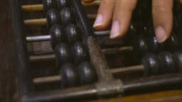 Hand Of Woman Use Old Abacus