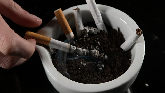 Hand of Woman with Cigarette and Ashtray, Real Time 4K