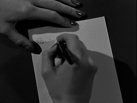 hand of woman writing letter with pen woman writing note on january 01 1955 in california - message stock videos & royalty-free footage