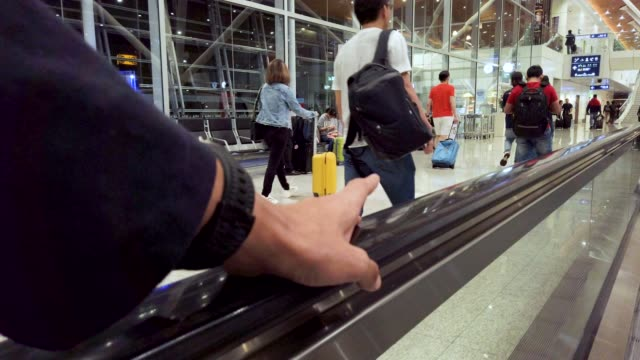 hand on moving walkway's handle - handle stock videos & royalty-free footage