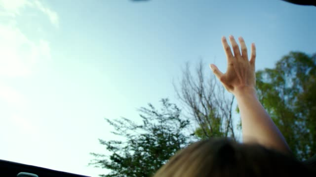 hand on sunroof - sun roof stock videos & royalty-free footage
