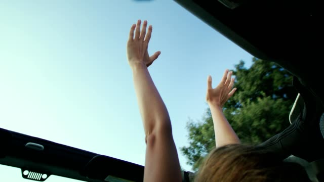 Hand on sunroof