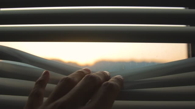 hand open blinds in the morning - blinds stock videos & royalty-free footage
