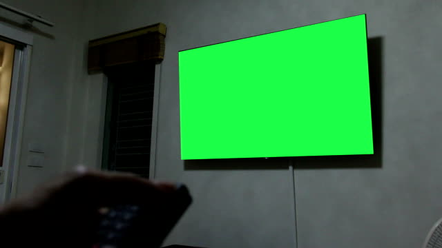 hand open smart tv via remote control with green screen monitor tv - computer monitor white background stock videos & royalty-free footage