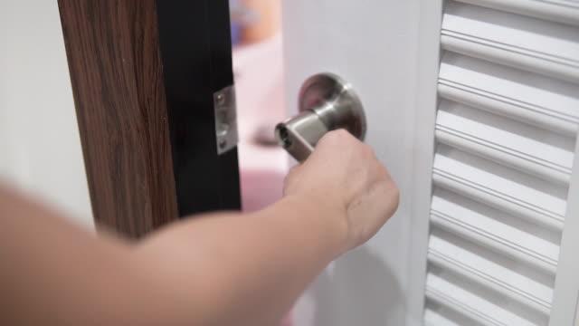 hand open the door. - handle stock videos & royalty-free footage