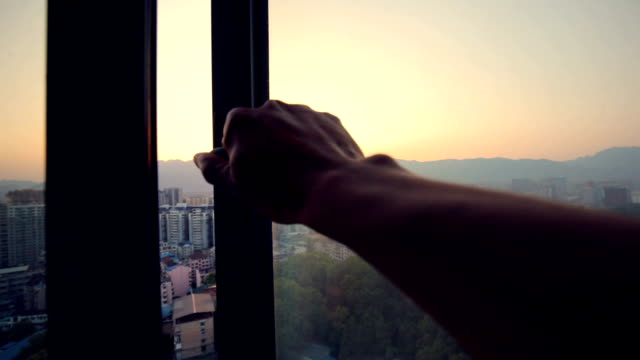 hand open window at sunrise - window frame stock videos and b-roll footage