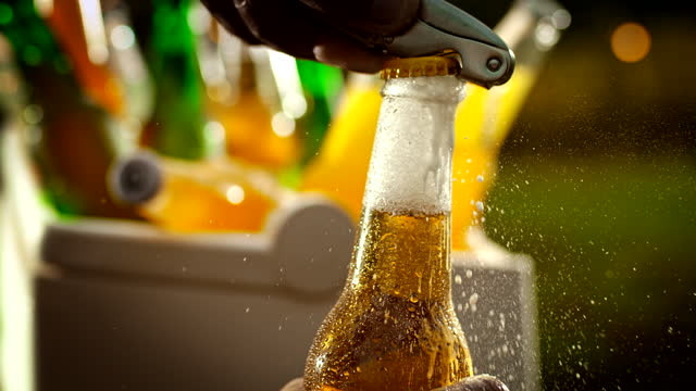 super slo mo hand opening a bottle of beer - cap stock videos & royalty-free footage