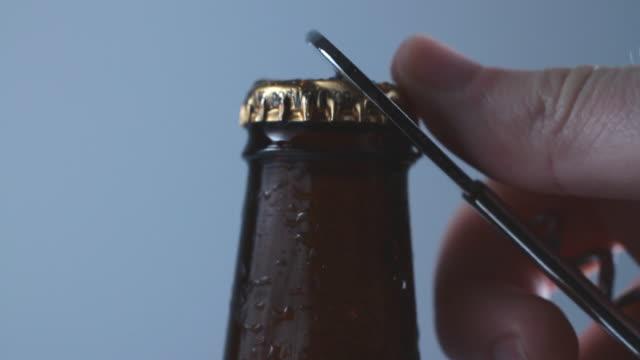 slo mo cu hand opening beer cap - beer cap stock videos & royalty-free footage