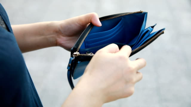 hand opening empty wallet - povertà video stock e b–roll
