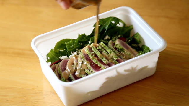 hand opening healthy lunch box, tuna salad. - low carb diet stock videos & royalty-free footage