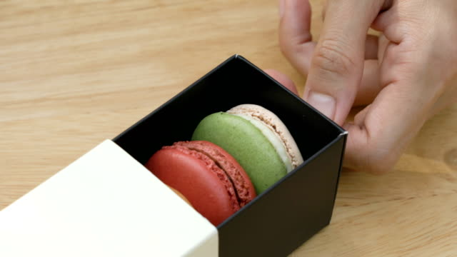 hand opening macarons box. - macaroon stock videos and b-roll footage