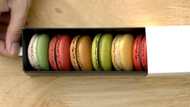 hand opening macarons box. - french food stock videos and b-roll footage