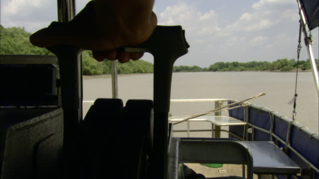 a hand operates the throttle on a boat. - throttle stock videos & royalty-free footage