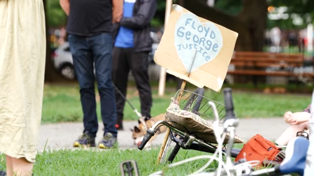 hand painted sign reads 'justic for george floyd.' live music and nightly speeches in mccarren park before the march through the streets of... - hipster person stock videos & royalty-free footage
