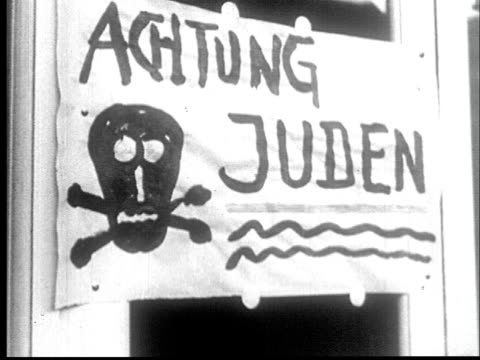 1942 cu hand painted sign with skull and crossbones saying attention jews - prelinger archive stock-videos und b-roll-filmmaterial