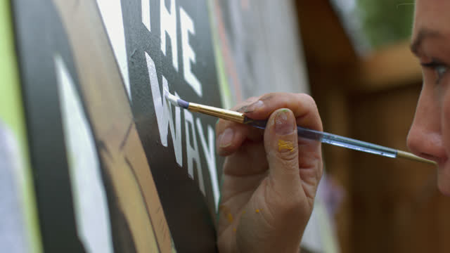 cu of hand painting a mural - drawing activity stock videos & royalty-free footage