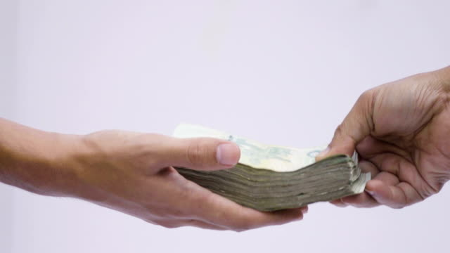 hand passing money slow motion - valuta video stock e b–roll
