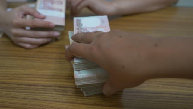 hand passing money - bribing stock videos & royalty-free footage