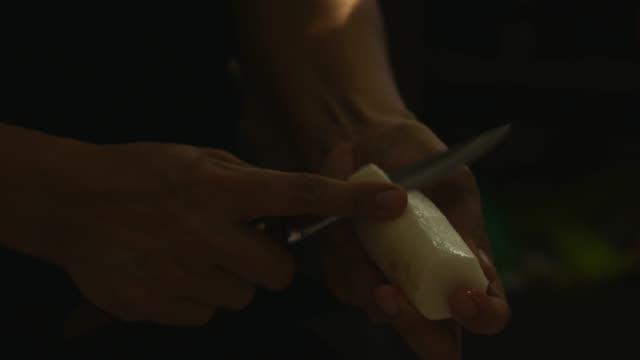 hand peeling radish - human limb stock videos & royalty-free footage