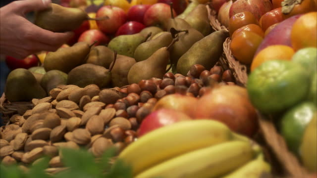 stockvideo's en b-roll-footage met a hand picking a pear sweden. - onbekend geslacht