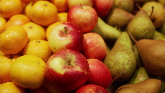 A hand picking an apple Sweden.