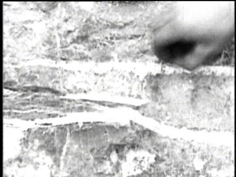 1921 cu hand picking debris from asbestos fibers embedded in natural rock / asbestos, quebec, canada - 1921 stock videos & royalty-free footage