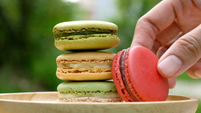 hand picking macarons out. - biscuit stock videos & royalty-free footage